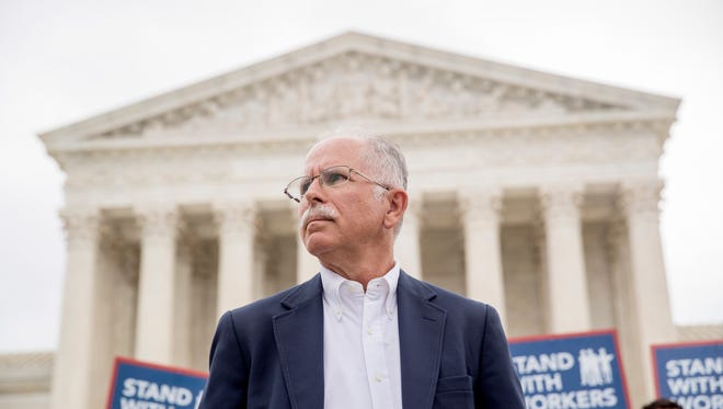 Plaintiff Mark Janus stands outside the Supreme Court on June 27 after the court ruled for him in a decision viewed as a significant setback for organized labor.