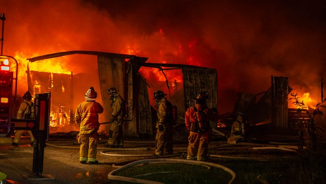 Firefighters work at the scene of a fully-involved 30x70 maintenance shed fire at the Bridges Golf Course on the first block of Lobell Rd., Saturday, July 7, 2018, in Berwick Township. United Hook & Ladder Chief Steve Rabine said the cause of the fire, which was dispatched around 12:48 at night, is undetermined due to the extensive damage, but doesn't appear to be suspicious in nature.