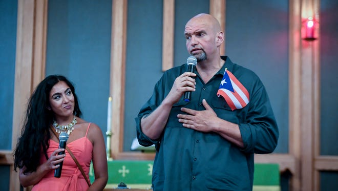 Gisele Fetterman, left, interprets for her husband, John Fetterman, who is running for lieutenant governor, during a Puerto Rico relief rally at Calvary United Methodist Church in York, Monday, July 23, 2018. John A. Pavoncello photo
