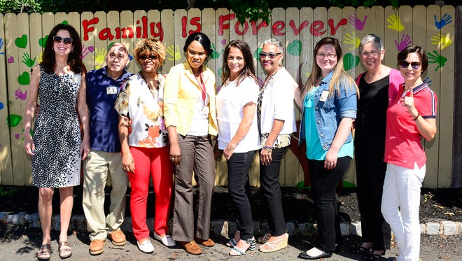 (Left to right) Pam Gabel, director of Community Relations; John Yumang, director of Building Services; Aurelie Ngoufack, director of Health Services; Karen Simpson, director of Food Services; Laura Parizeau, concierge; Annette Watson, executive director; Kim Wolf, director of the Country Cottage; Arlene Nelson, business office manager; and Jane Pritsker, director of Lifestyles.