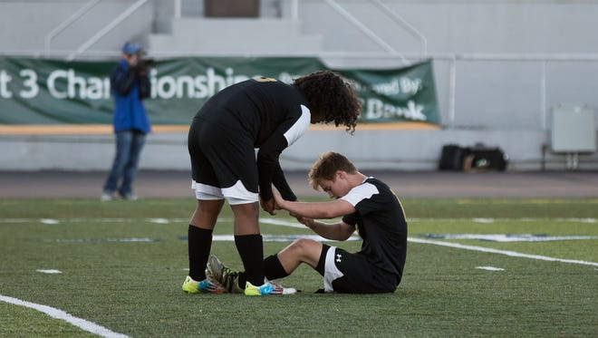 Biglerville's Alejandro Morales consoles teammate Jared Dotson-Jones after the Canners lost to Tulpehocken in the District 3 Class 2A boys' soccer championship game in 2016. Morales was found dead on July 25, 2018.