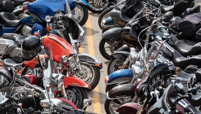 Motorcycles are parked along Main Street during the 78th annual Sturgis Motorcycle Rally, in Sturgis, S.D., Friday, Aug. 3, 2018.  (Ryan Hermens/Rapid City Journal via AP)