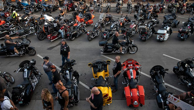 In this Saturday, Aug 4, 2018 photo, motorcycles fill Main Street in downtown Sturgis, S.D., during the 78th annual Sturgis Motorcycle Rally. (Ryan Hermens/Rapid City Journal via AP)