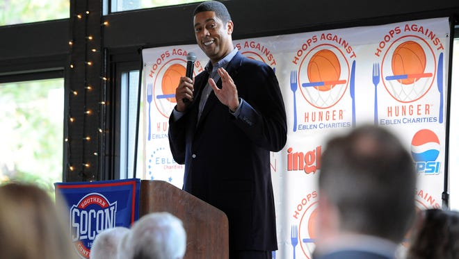 Brad Daugherty tells stories of playing college basketball at UNC Chapel Hill while delivering remarks at a Southern Conference luncheon in 2014.
