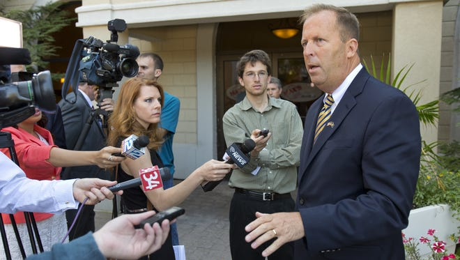 Kevin Law, chairman of the Gaming Facility Location Board, speaks to the media in Ithaca in September.