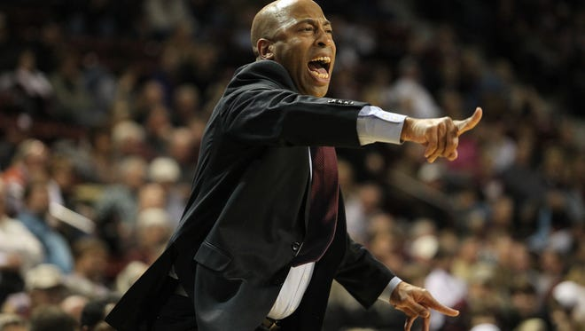 Mississippi State head coach Rick Ray calls out to his players in the Bulldogs' game against Auburn.