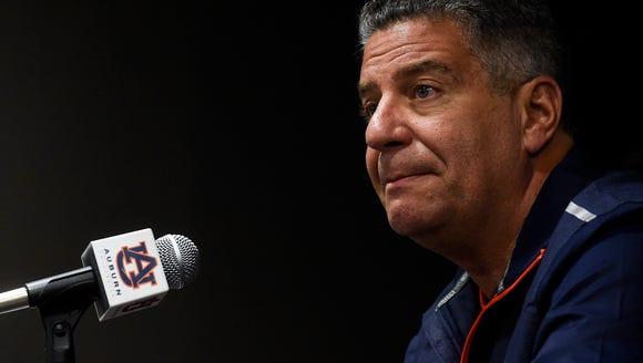 Auburn men's basketball coach Bruce Pearl make his