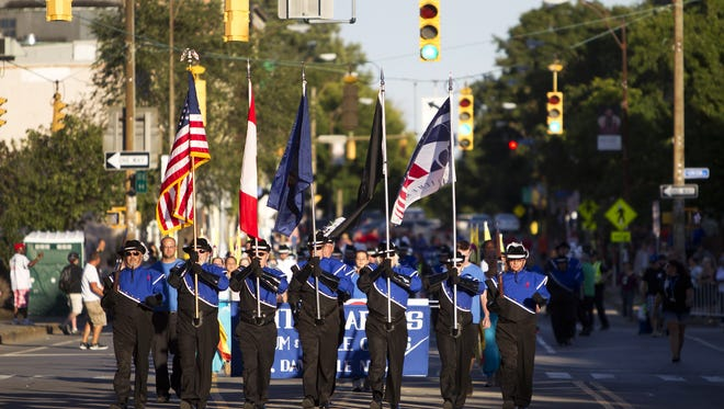 The Labor Day parade makes its way down East Ave. on Friday, August 29, 2014.