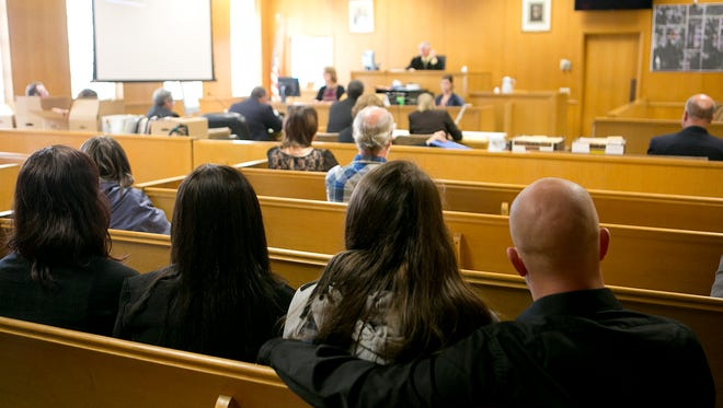Family members of Dale Meister watch court proceedings  on the first day of the Joseph Reinwand homicide trial at Wood County Courthouse in Wisconsin Rapids, Monday, Oct. 20, 2014.