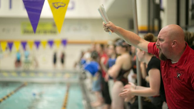Wausau East head swim coach Derek Steinke encourages a swimmer during the Wisconsin Valley Conference girls championship swim meet at the University of Wisconsin-Stevens Point, Thursday, Oct. 30, 2014.