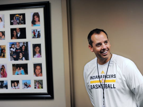 Indiana Pacers head coach Frank Vogel is all smiles as he talks about his family as photos hang on his wall in his office inside the Bankers Life Fieldhouse on Oct. 28, 2013.