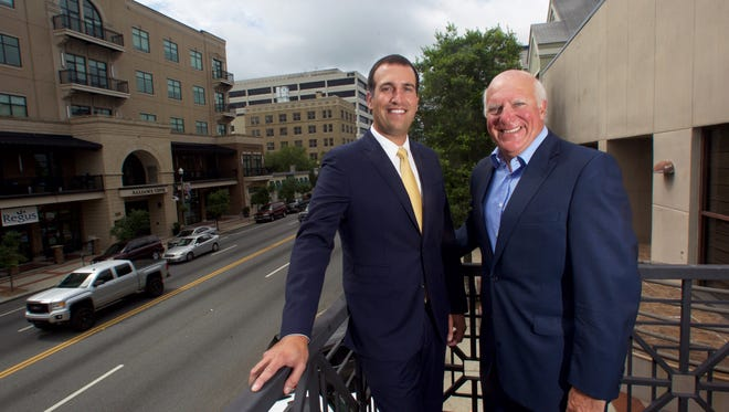 Cory Guzzo and his father Gary work together at the Floridian Partners Office downtown.