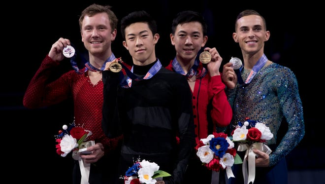 Second place Ross Miner, first place Nathan Chen, third place Vincent Zhou, and fourth place Adam Rippon pose for a photo after the men's free skate program.