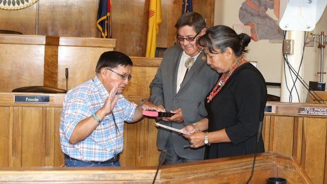 Peterson B. Yazzie, left, takes the oath of office to serve as an interim delegate on the Navajo Nation Council on Wednesday in the council chamber in Window Rock, Ariz. Yazzie will replace Mel R. Begay, who represented  Bahastl'ah, Coyote Canyon, Mexican Springs, Naschitti and Tohatchi chapters.
