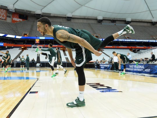 Michigan State Spartans guard Denzel Valentine stretches during practice for the semifinals of the midwest regional of the 2015 NCAA Tournament at Carrier Dome on March 26, 2015.