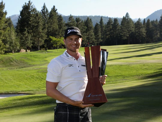 Chris Stroud poses with the trophy after winning the Barracuda Championship at Montreux Golf & Country Club on Aug 6.
