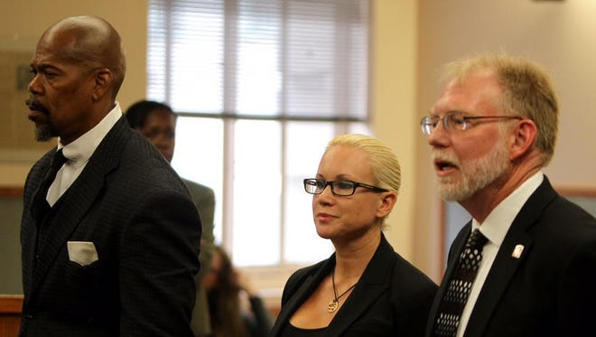 Crysta Pleatman (middle) stands with her lawyers Clyde Bennett and Paul Croushore on Sept. 29.