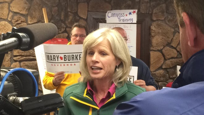 Democratic gubernatorial candidate Mary Burke talks to reporters Saturday at the Brown County party headquarters. (Oct. 18, 2014)