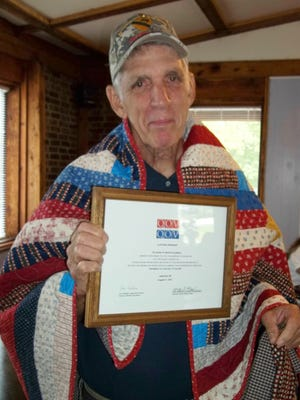 Clifford Springer, veteran of the US Army, 1st Cavalry, Vietnam and recipient of the Purple Heart, was awarded a Quilt of Valor by Mountain Home Quilts of Valor recently. Springer, of Yellville, received his Quilt at a ceremony in Lakeview.