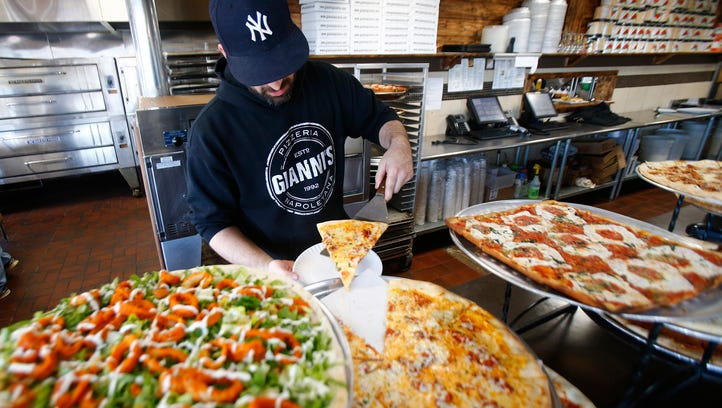 Gianni's Pizzeria Red Bank manager Nick Falabella serves