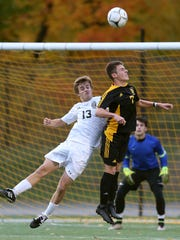 Honeoye Falls Lima's Parker Hotchkiss (13) is called for the foul against Athena's CJ Takatch (7) in a match last fall.