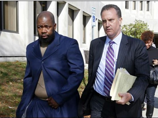 Tyrone Mushatt, left, former Westchester Community College men's basketball coach, and his attorney John Pappalardo leave Mount Pleasant Town Hall after Mushatt's arraignment on Oct. 29, 2015.