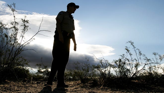 Patrick Brasington, Phoenix District chief ranger at the Bureau of Land Management, inspects land on the Sonoran Desert National Monument. Volunteers are needed for a cleanup project along the northern boundary of the monument on April 25.