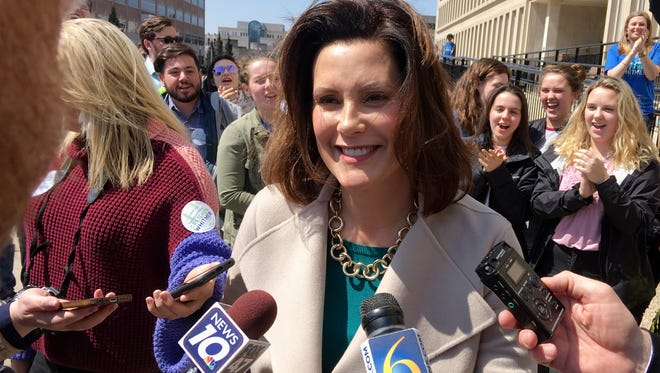 In this April 12, 2018, file photo, Michigan Democratic gubernatorial candidate Gretchen Whitmer speaks with reporters outside the state elections bureau in Lansing, Mich.  (AP Photo/David Eggert, File)