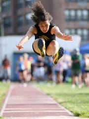 Bergen County Track Meet of Champions at Hackensack High School on Friday, May 19. 2017. Tiffany Bautista, of Paramus Catholic, competes in the triple jump.