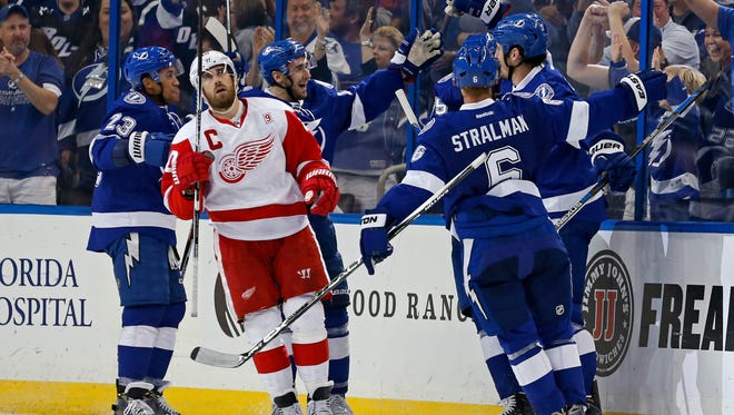 Red Wings captain Henrik Zetterberg reacts as members of the Tampa Bay Lightning celebrate a goal during the third period Oct. 13, 2016 in Tampa, Florida.