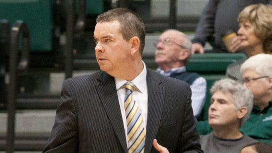 Binghamton men's basketball coach Tommy Dempsey paces