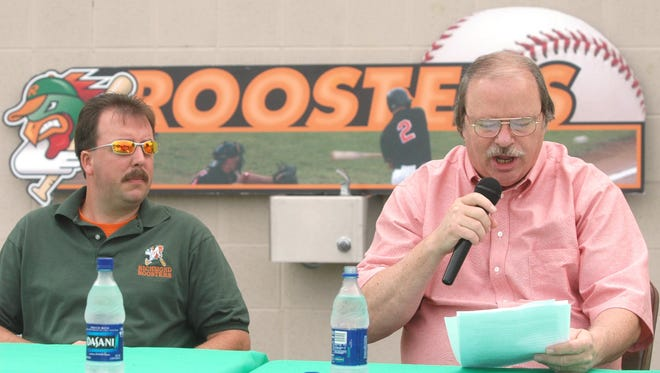 Roosters majority owner Allen Brady, left, listens as minority owner Duke Ward reads a statement about the sale of the ball club to a couple in Traverse City, Mich., during a press conference at McBride Stadium Friday morning, July 1, 2005.