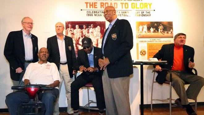 Members of the 1966 Texas Western College basketball championship team gather together at a special exhibit on the team in the Union building on the UTEP campus Thursday. They are from left: Louis Boudoin, Willie Cager, Dick Myers, David Lattin, Nevil Shed and Togo Railey, far right. Team member Orsten Artis and former assistant coach Moe Iba were also present.