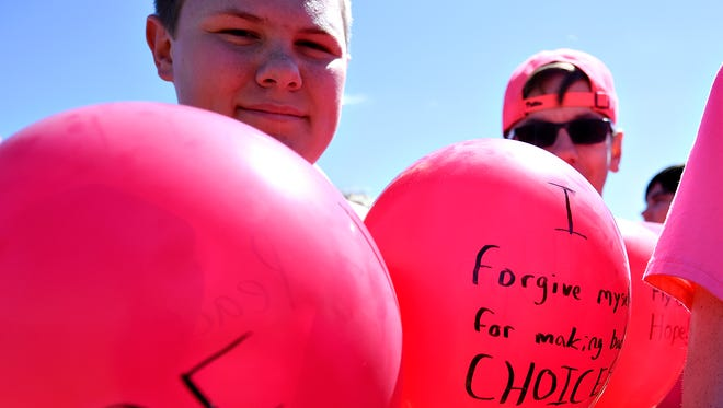 Northeastern Middle School eighth grader Adam Duncker, 13, holds balloons as the school gathers for Rachel's Challenge Balloon Release and Hope Westrick Tribute at the school in Mt. Wolf, Tuesday, March 29, 2016. Westrick, who was a ninth grader at the school, died in December 2015 after battling cancer for more than two years. Dawn J. Sagert photo