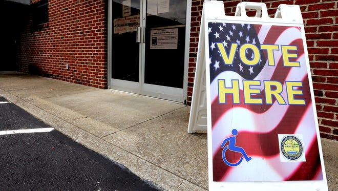 """This """"VOTE HERE' signs is by the rear entrance of Smyrna Town Hall, which is one of seven early voting polling locations offered by the Rutherford County Election Commission. E2016."""