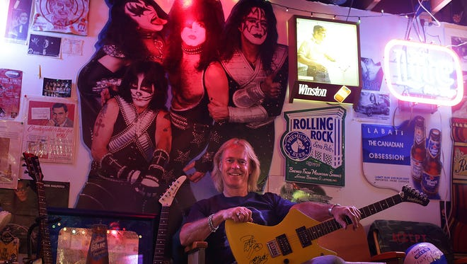 Brad Lemerond of Green Bay has an impressive collection of memorabilia devoted to KISS, including a guitar autographed by Gene Simmons and Peter Criss. He'll be at the band's concert Wednesday at the Resch Center -- his 19th time to see them live.