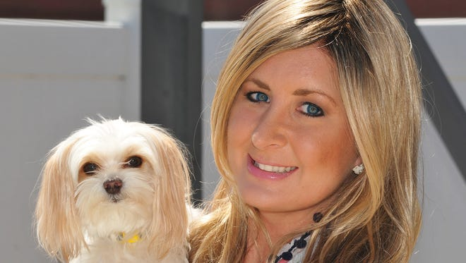 Lindsay Farlow of Melbourne, Fla., seen here with her dog Daisy Mae, was diagnosed with breast cancer at age 32. She's now 33 and in remission.