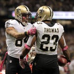 New Orleans Saints wide receiver Kenny Stills (84) congratulates running back Pierre Thomas (23) after Thomas' first of two touchdowns against the Tampa Bay Buccaneers in an NFL game Sunday, October 5, 2014, at the Mercedes-Benz Superdome in New Orleans, La. New Orleans won 37-31 in overtime.