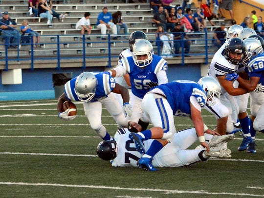 Carlsbad's Dominic Rodriguez fights for extra yards