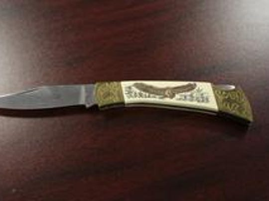 Police said a knife-wielding Subway robber discarded layers of clothing, as well as this knife, as he fled on Dec. 26, 2016.