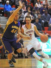 Lincoln's Carson Coulter (3) drives past Watertown's