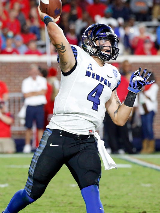 Memphis quarterback Riley Ferguson (4) passes during the second half of an NCAA college football game against Mississippi, Saturday, Oct. 1, 2016, in Oxford, Miss. Mississippi won 48-28. (AP Photo/Rogelio V. Solis)