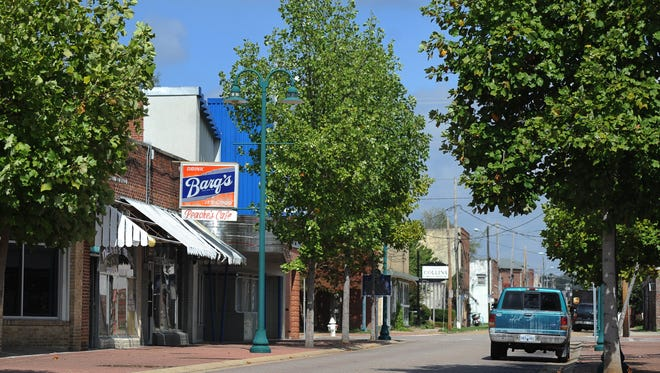 Farish Street in Jackson appears nearly deserted around mid-day on Wednesday.  Long-anticipated redevelopment of the historic area has stalled.