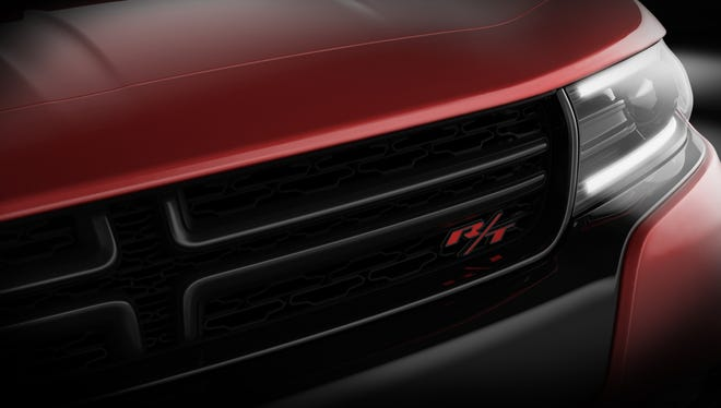 Teaser  photo of the new hood, grille, headlights and led running lights on the redone new 2015 Dodge Charger sedan to be unveiled next week at the New York Auto Show.