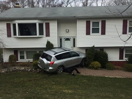 Driver crashes into Airmont home