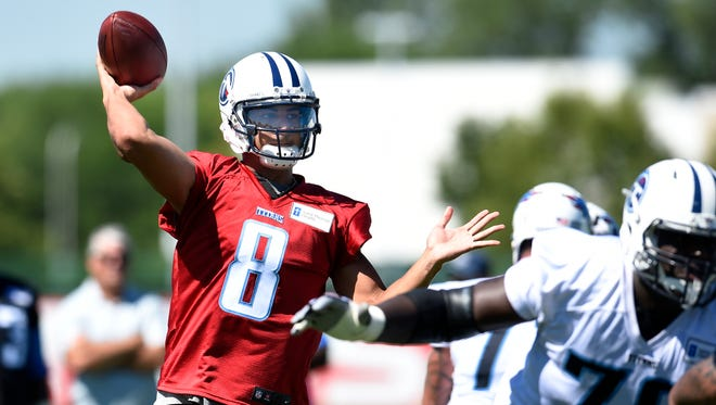 Titans quarterback Marcus Mariota (8) throws a pass during practice at St. Thomas Sports Park Friday July 31, 2015, in Nashville, Tenn.