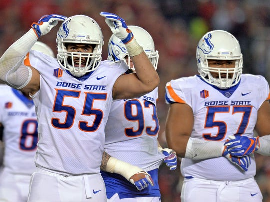 Boise State defensive tackle David Moa (55) reacts after a big play last season.