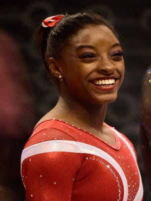 Simone Biles  chats with another competitor before warm-ups for the second day of the senior national championships at Bankers Life Fieldhouse.