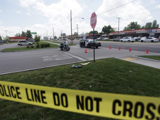 Springfield police investigate what  they say is an officer involved shooting on Glenstone Avenue just north of Bennett on Friday, May 9, 2014.