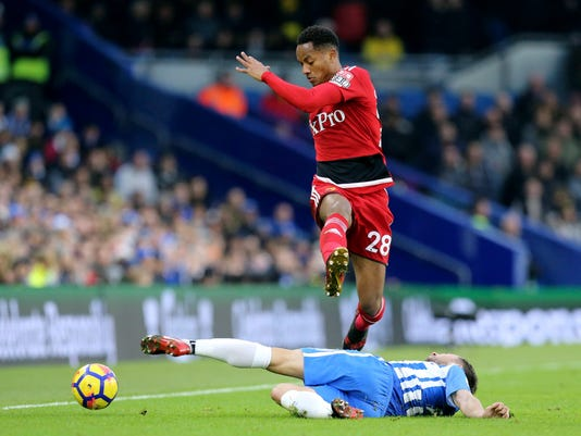 Watford's Andre Carrillo, in air, and Brighton & Hove Albion's Markus Suttner battle for the ball during the English Premier League soccer match between Brighton and Watford,  at the AMEX Stadium, in Brighton, England, Saturday, Dec. 23, 2017.  (Gareth Fuller/PA via AP)